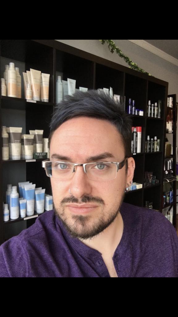 Josh in his hair salon.