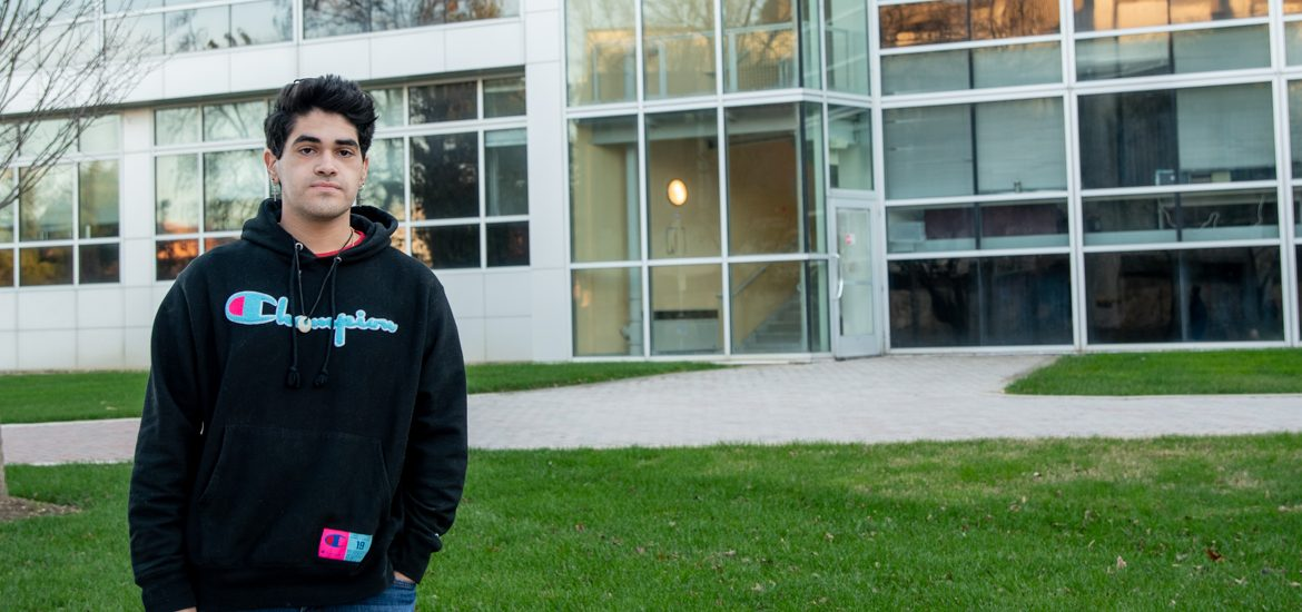 Emilio standing outside of the Science building.