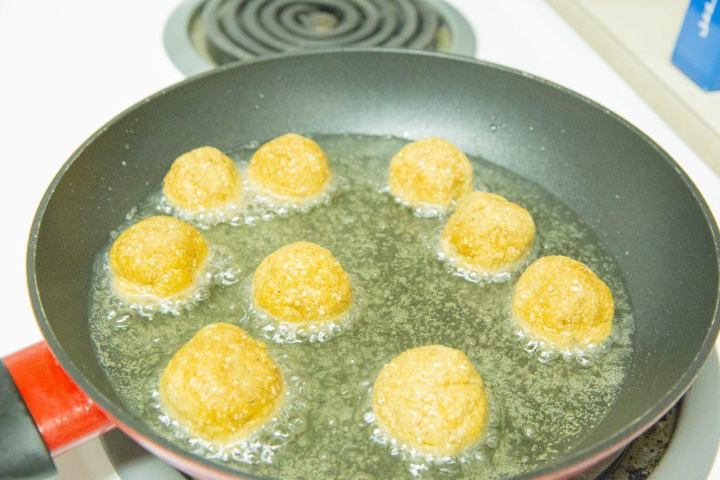 Frying the falafel in oil.