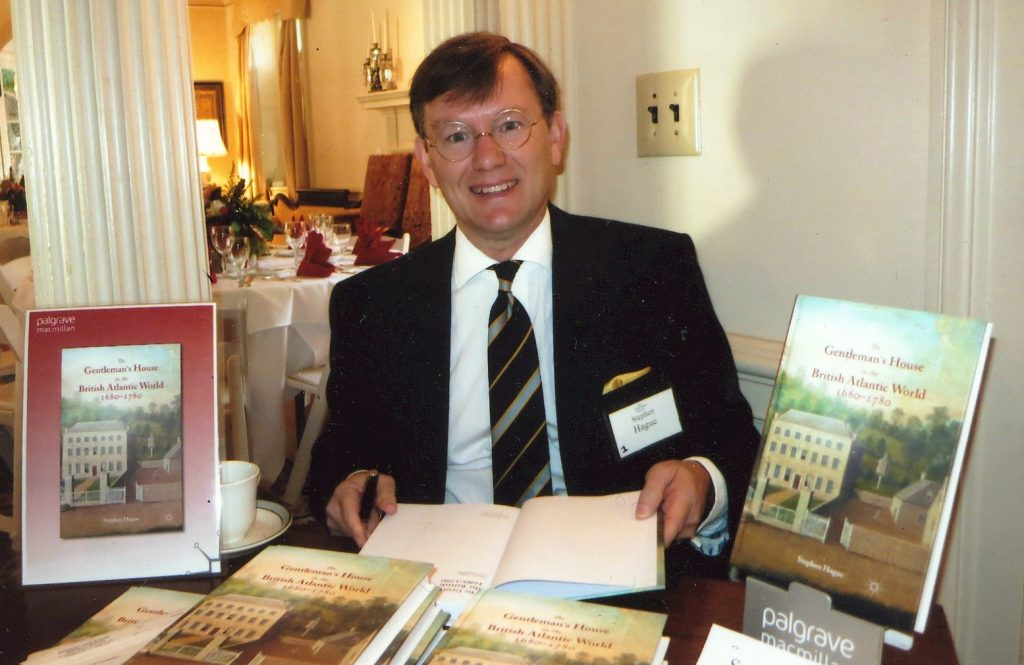 Dr. Hague poses at a book signing for his first book.