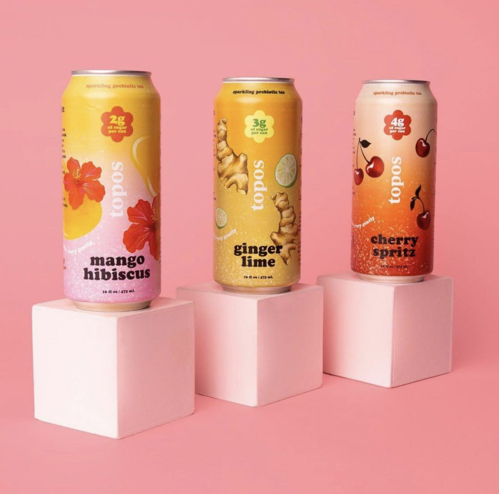 Three cans of Topos Teas.