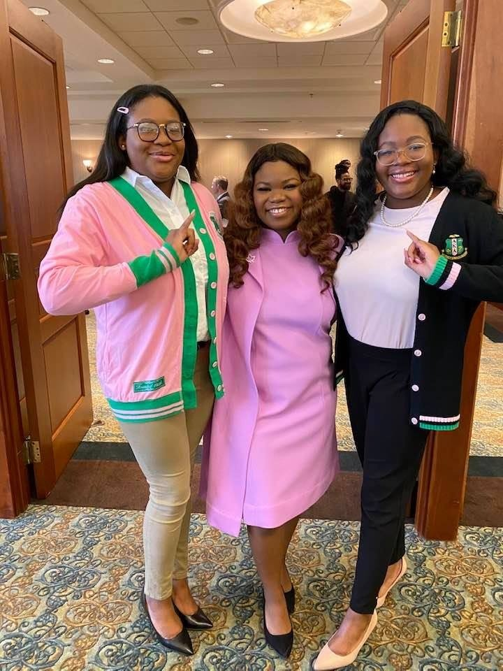 Sisters Ayala Gedeon, Dyone Payne, and Arielle Gedeon (from left to right) pose at an Alpha Kappa Alpha event.