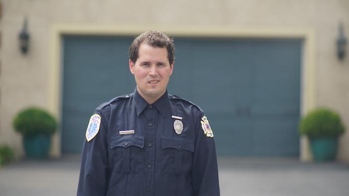 Josh wearing a police uniform.