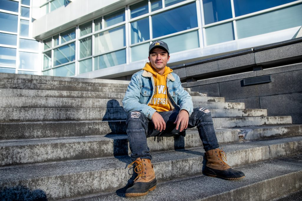 Bredon sitting on engineering steps.