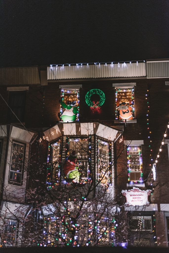 House decorated with lights and Christmas decor.