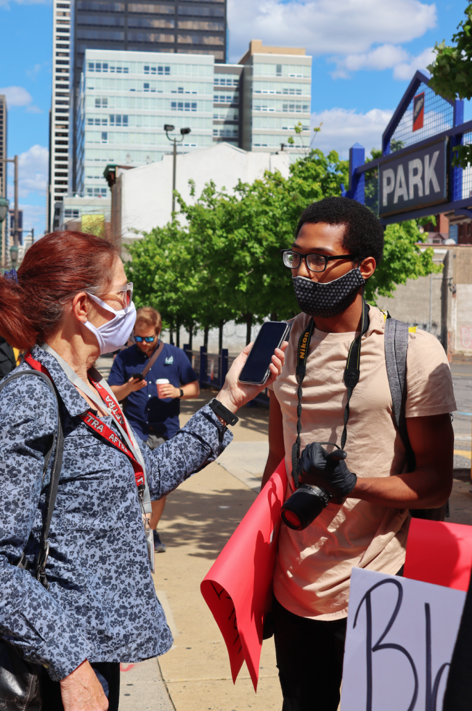 Chase being interviewed at a protest.