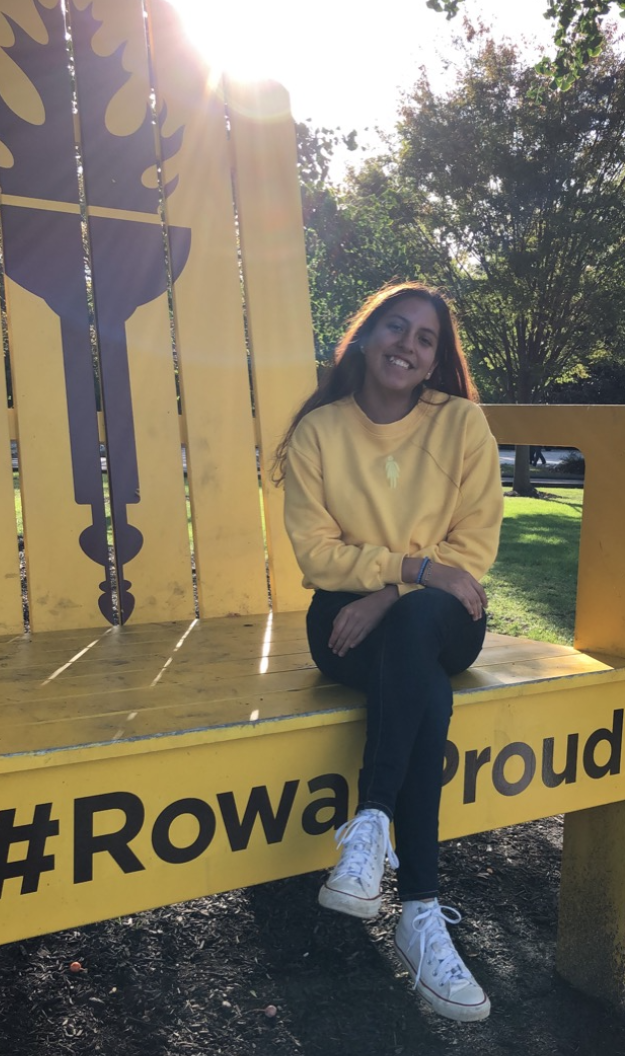 Angelica sitting on the giant chair on Rowans Bunce field while wearing a yellow shirt to match.