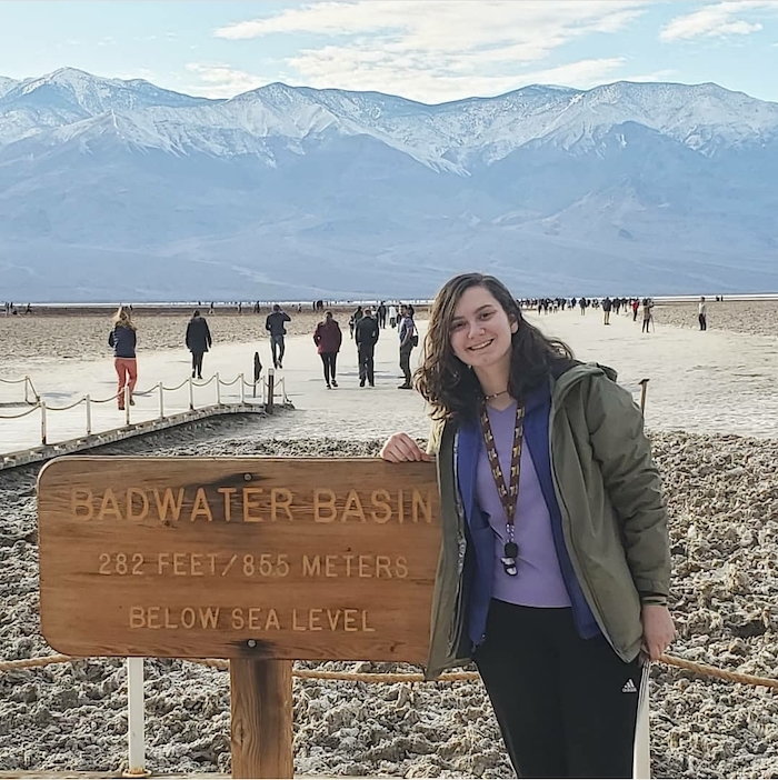 Tara posing in front of the Badwater Basin sign.