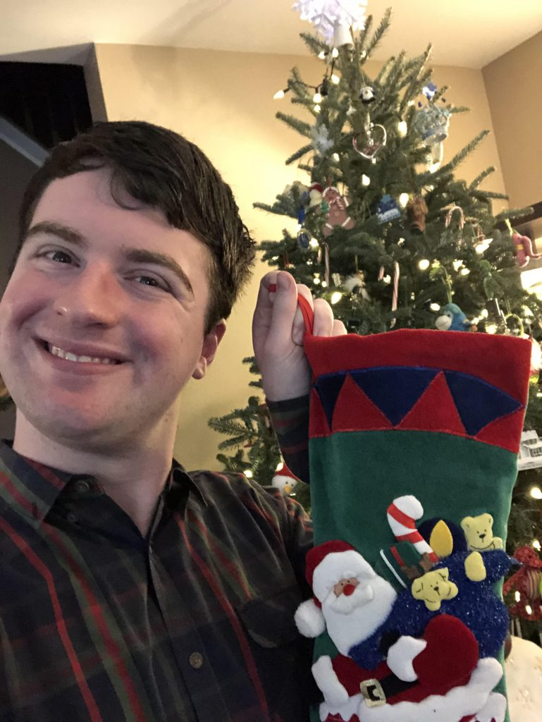 Alex poses with his stocking.