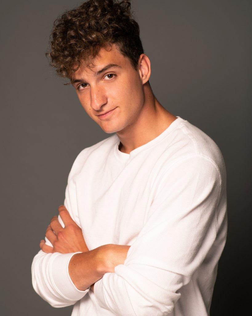 Erik poses against a gray backdrop.