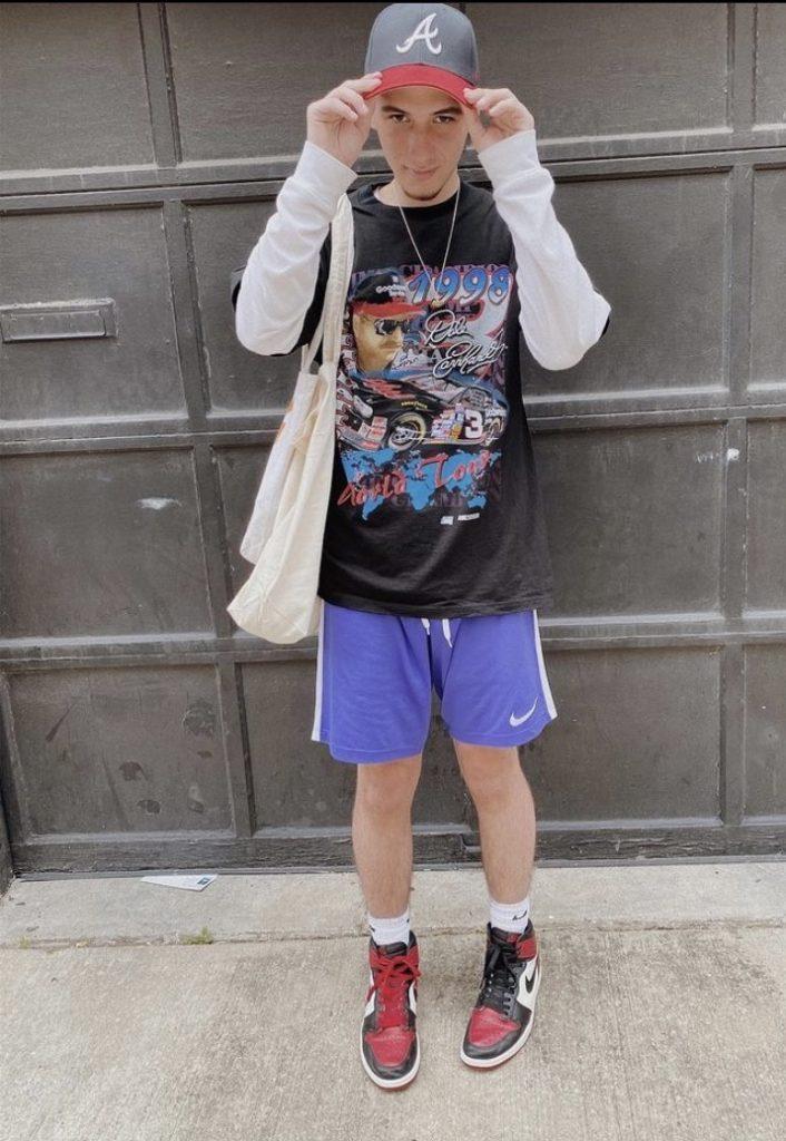 David Rodriguez stands in front of a garage door.
