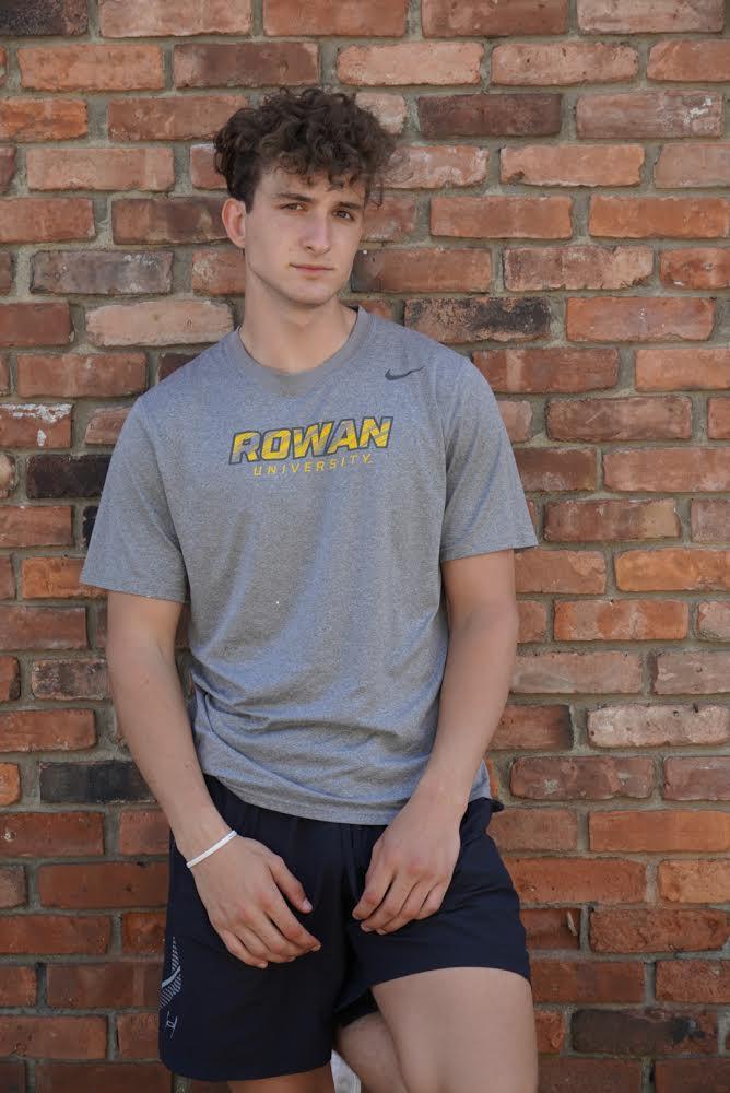 Erik poses in a Rowan shirt.