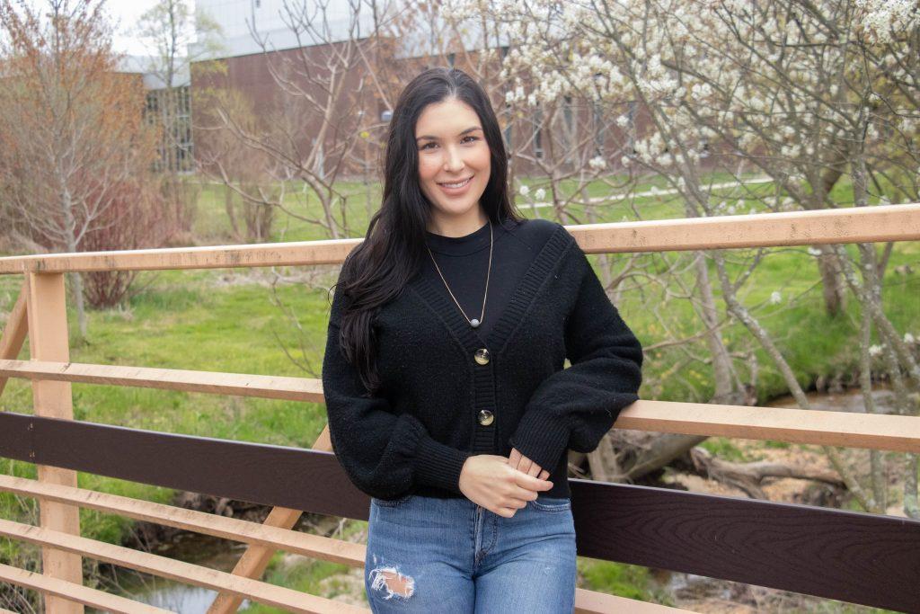 Talia poses on the bridge behind Wilson Hall.