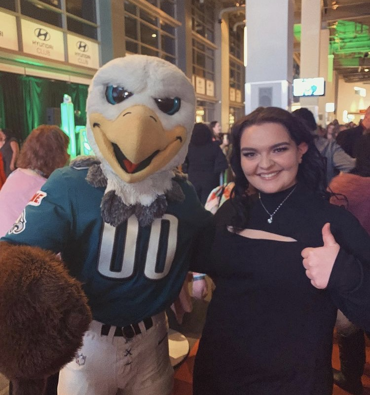 Jennifer poses with the Eagles mascot.