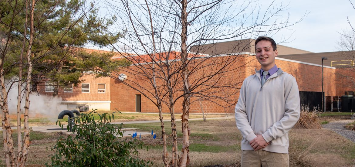 Steven poses outside by the Rec Center at Rowan.