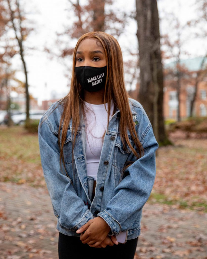 Tara standing outside with a Black Lives Matter mask.