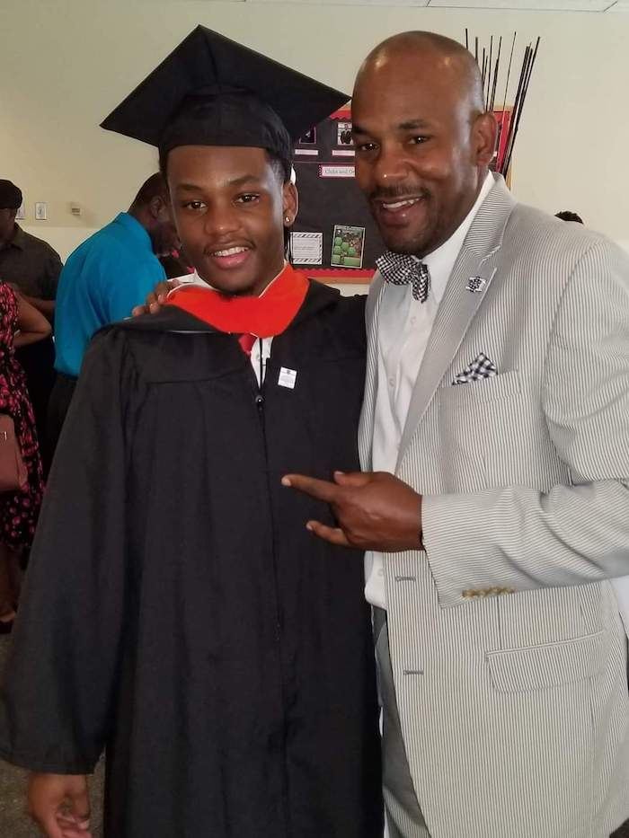 Brad proudly stands with his son Kyndell, who graduated from college.