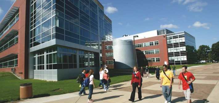 Exterior shot of students walking past Science Hall.