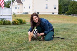 Kristi holding her English Bull Dog named Tank.