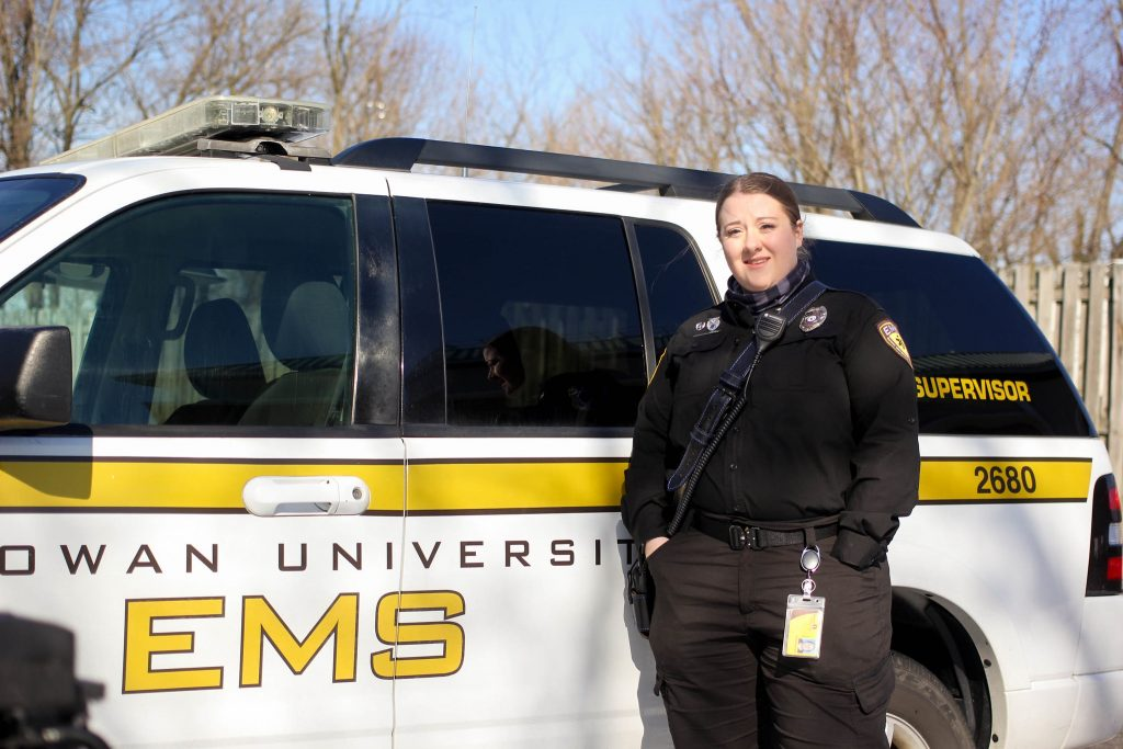 Maribeth in front of a Rowan EMS vehicle.