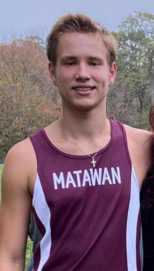 Bobby wearing a Matawan high school track jersey.