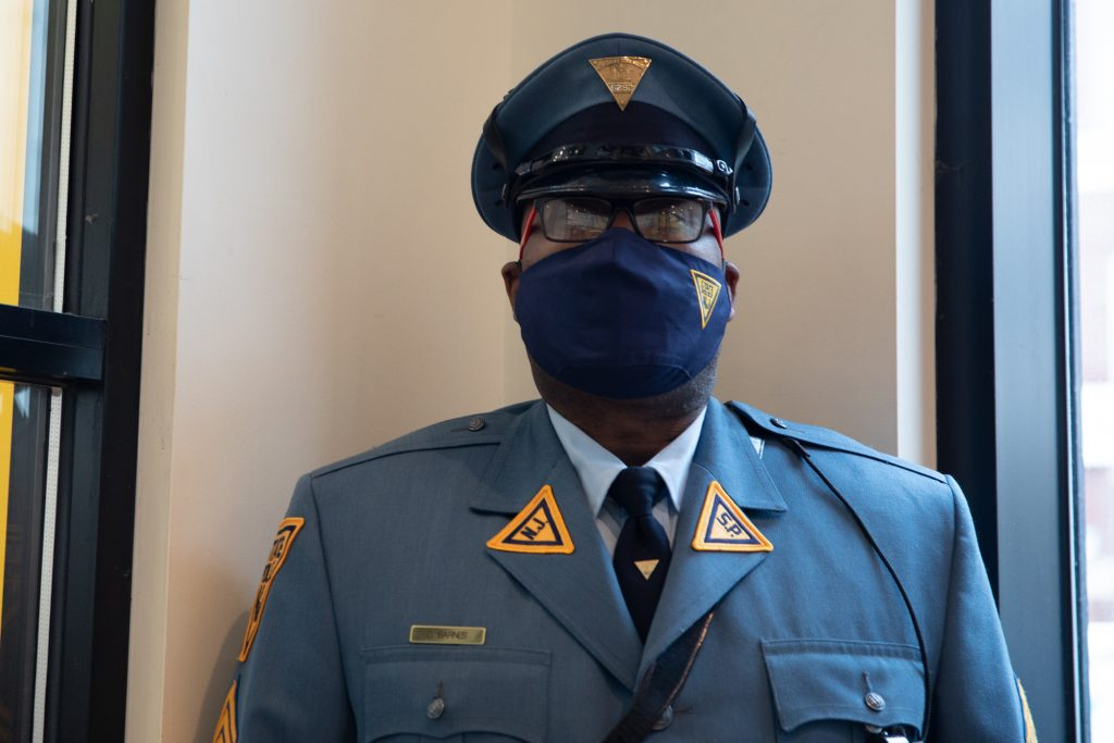 Headshot of Sgt. Barnes wearing a state police mask.