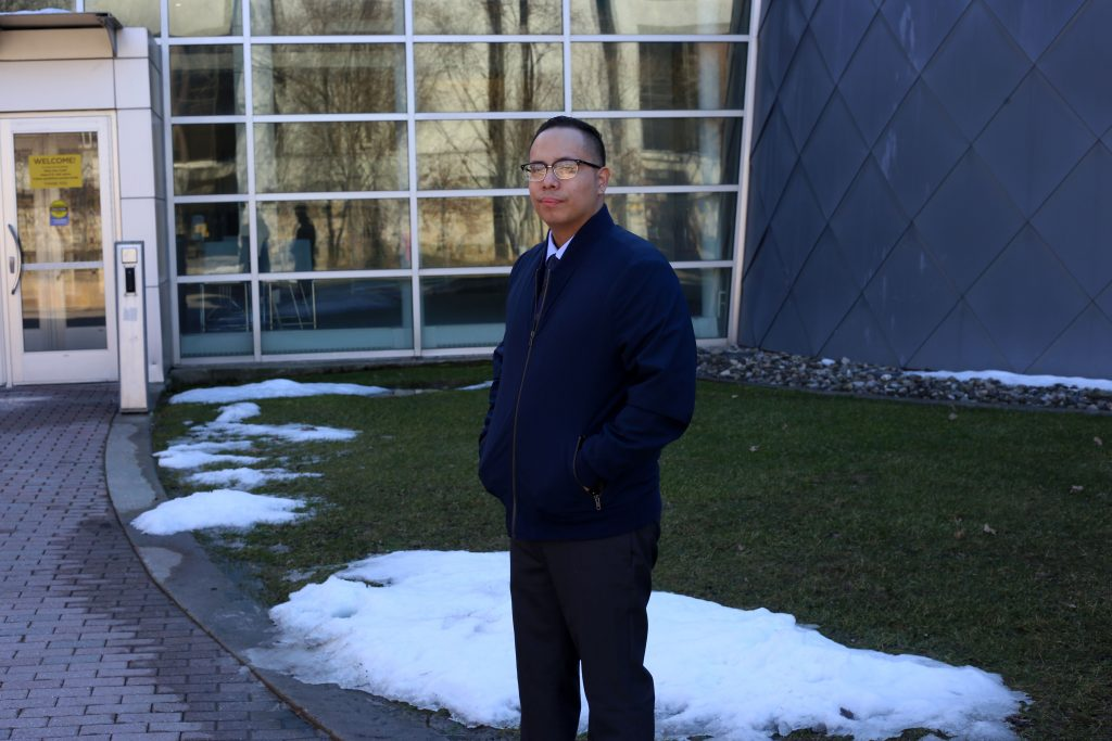 Abraham poses in front of Science Hall.