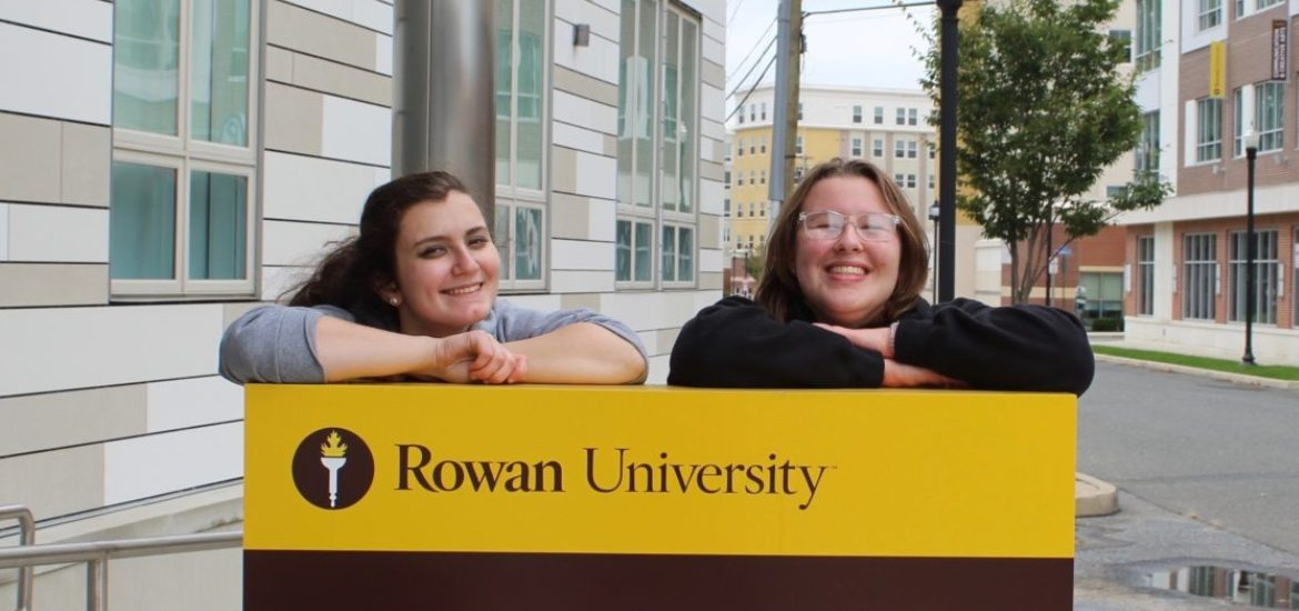 Two Rowan students stand in front of 301 High St.
