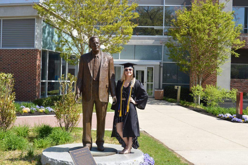 Amanda Paton in front of Henry Rowan Statue