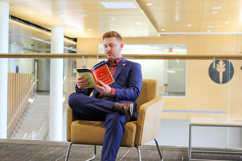 Joe Sansone reads a book inside Business Hall.
