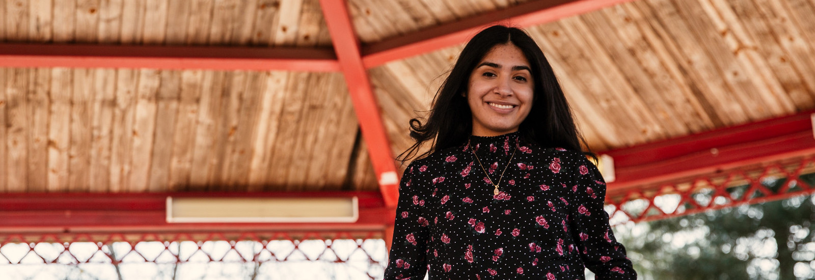 Brittany stands underneath a gazebo on campus.