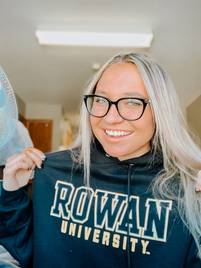 Autumn posing for a selfie while showing off her Rowan sweatshirt.
