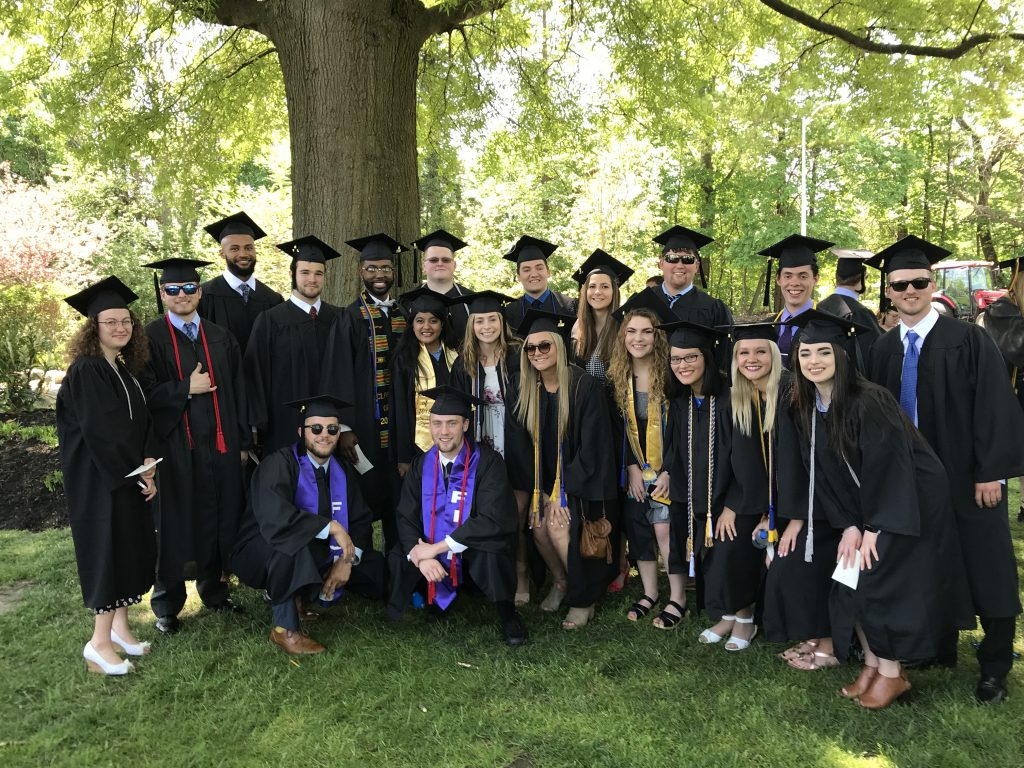 Amanda with friends and fellow students at her commencement.