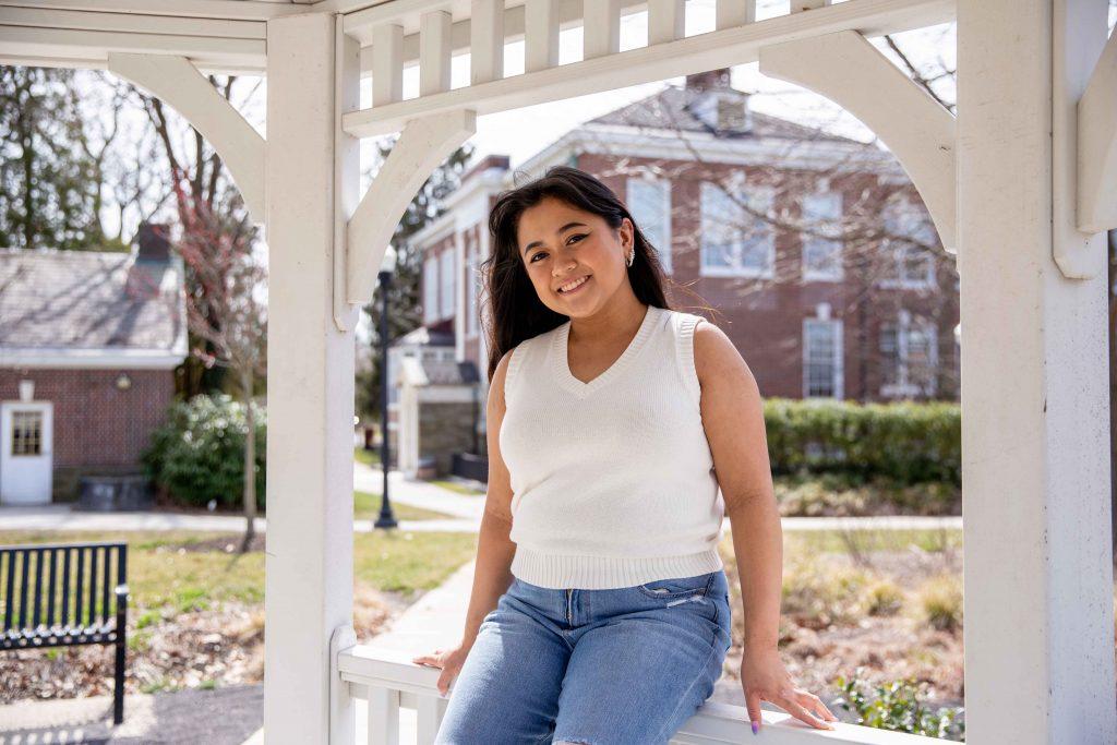 Gabrielle outside sitting in a gazebo.