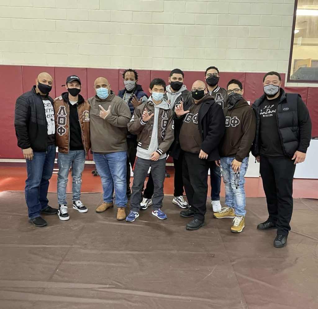 Chris and some of his brothers from other South Jersey and Pennsylvania chapters pose at a community service event they put on together.