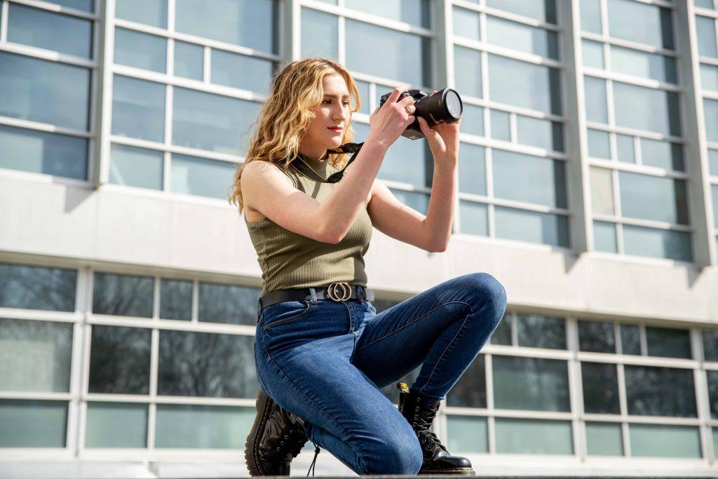Jill adjusts her camera settings.