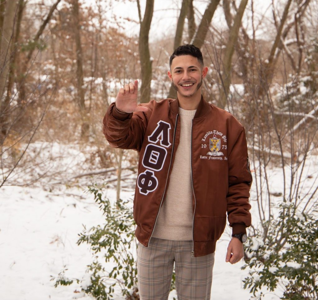 Chris poses outdoors in a snowy, wooded area.