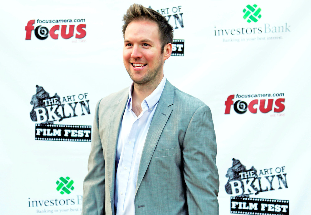 Ryan attends The Art of Brooklyn Film Festival in a suit.