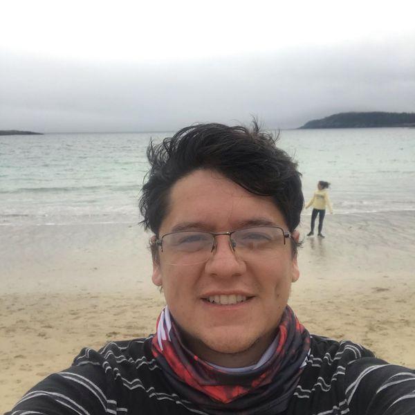 A selfie of Fabrizio on a beach.