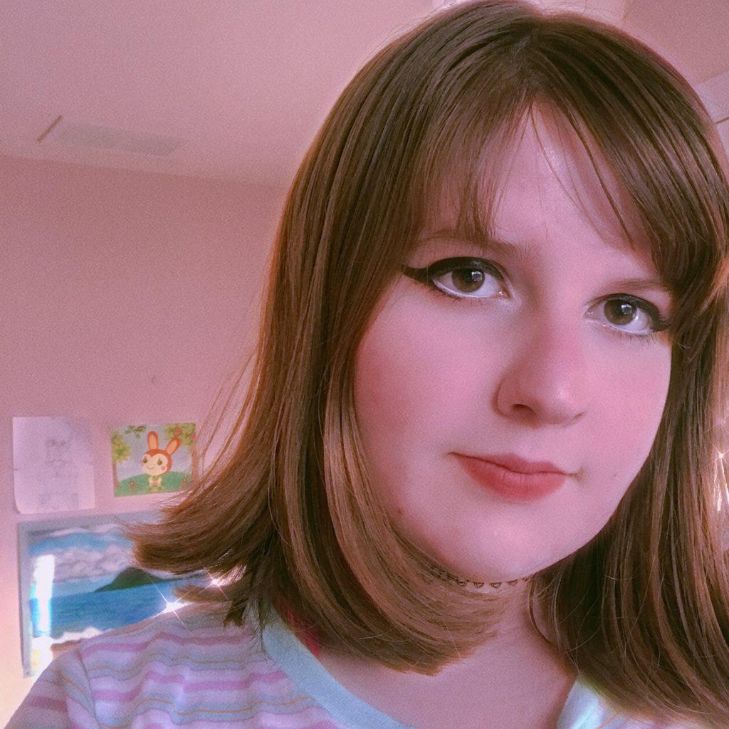 Selfie of Maddie in a pink room.