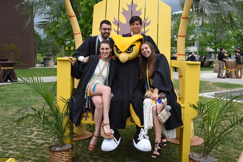 Students sitting on the Rowan Proud Chair.