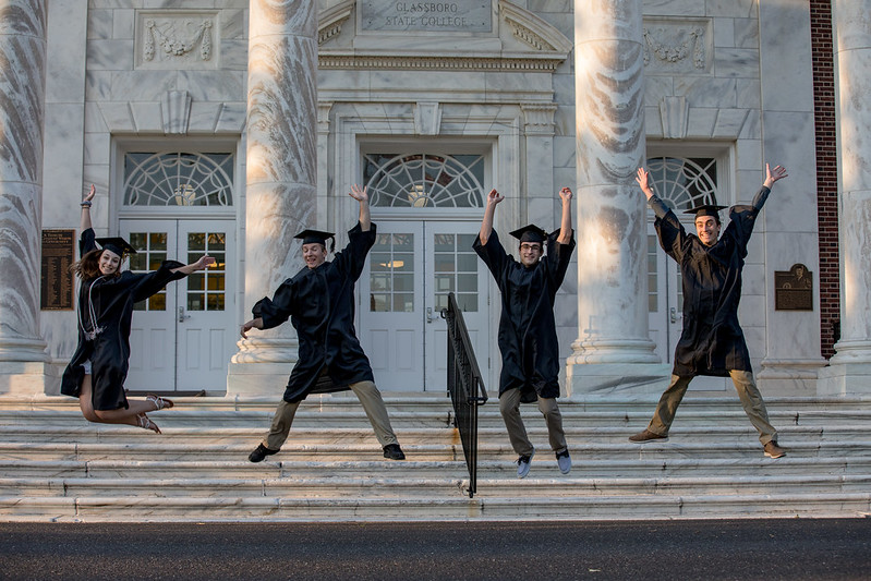Students jumping in front of Bunce.