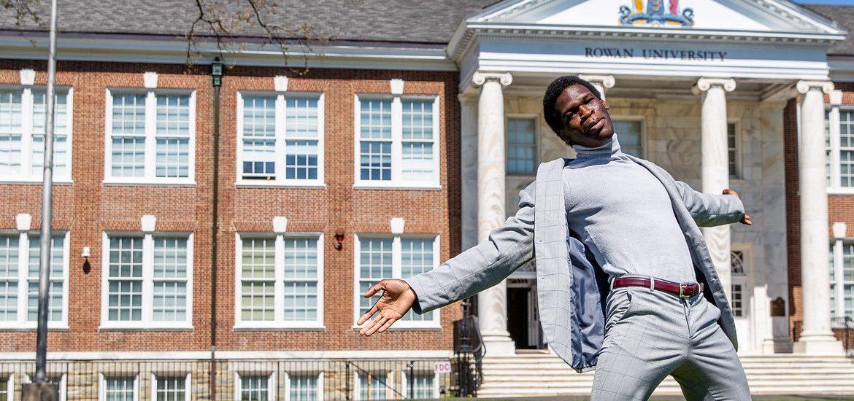 Joshua poses outside of Bunce Hall.
