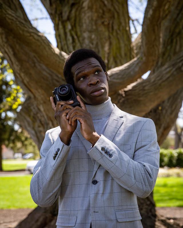 Joshua holds his camera on Bunce Green.