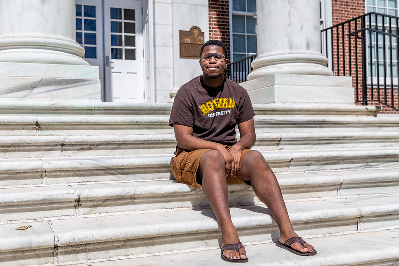 Alex sits on the steps of Bunce Hall.