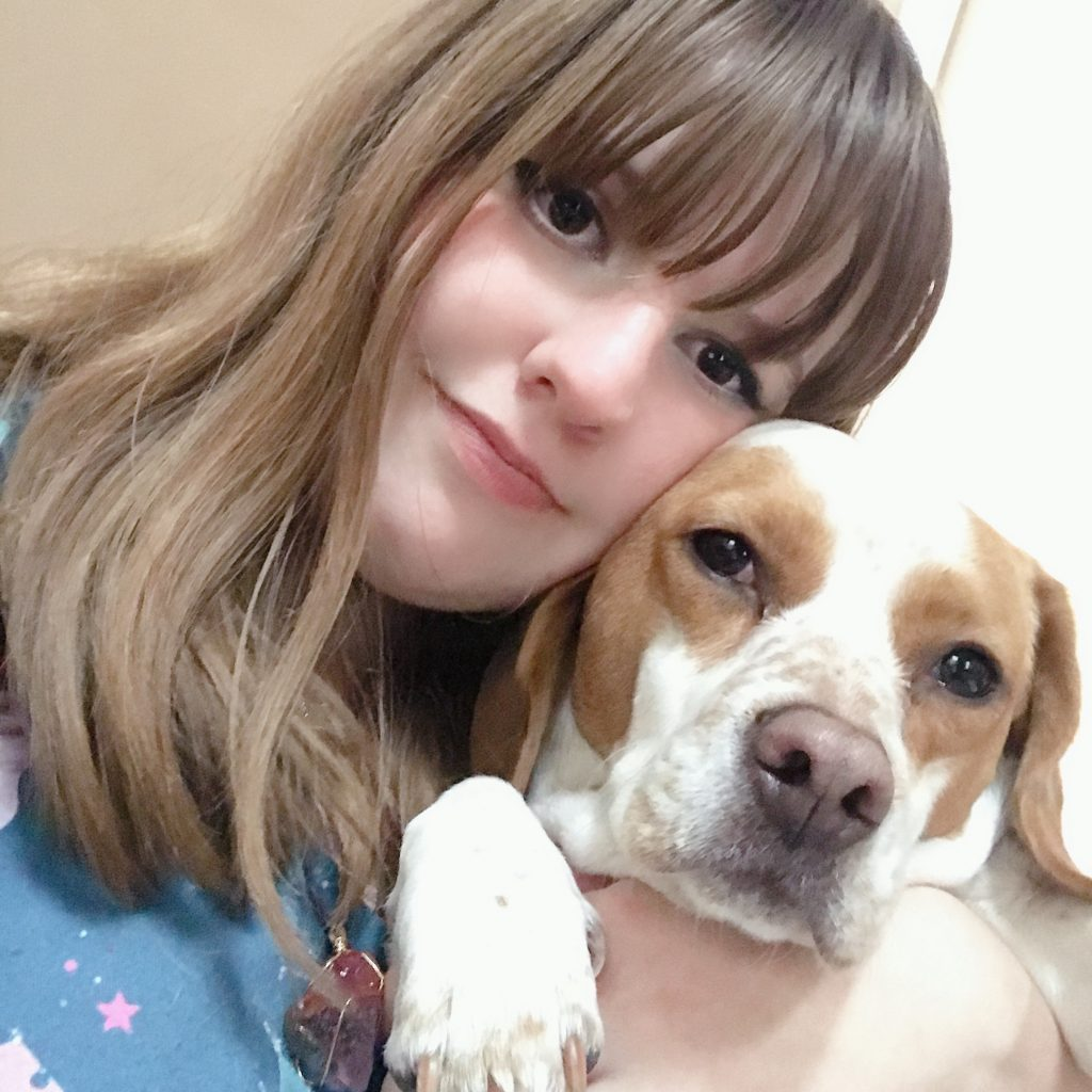 Selfie of Maddie and a dog.