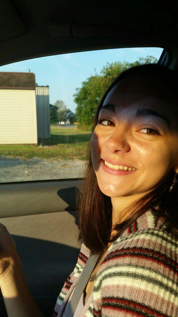 Photo of Alyssa in a car.
