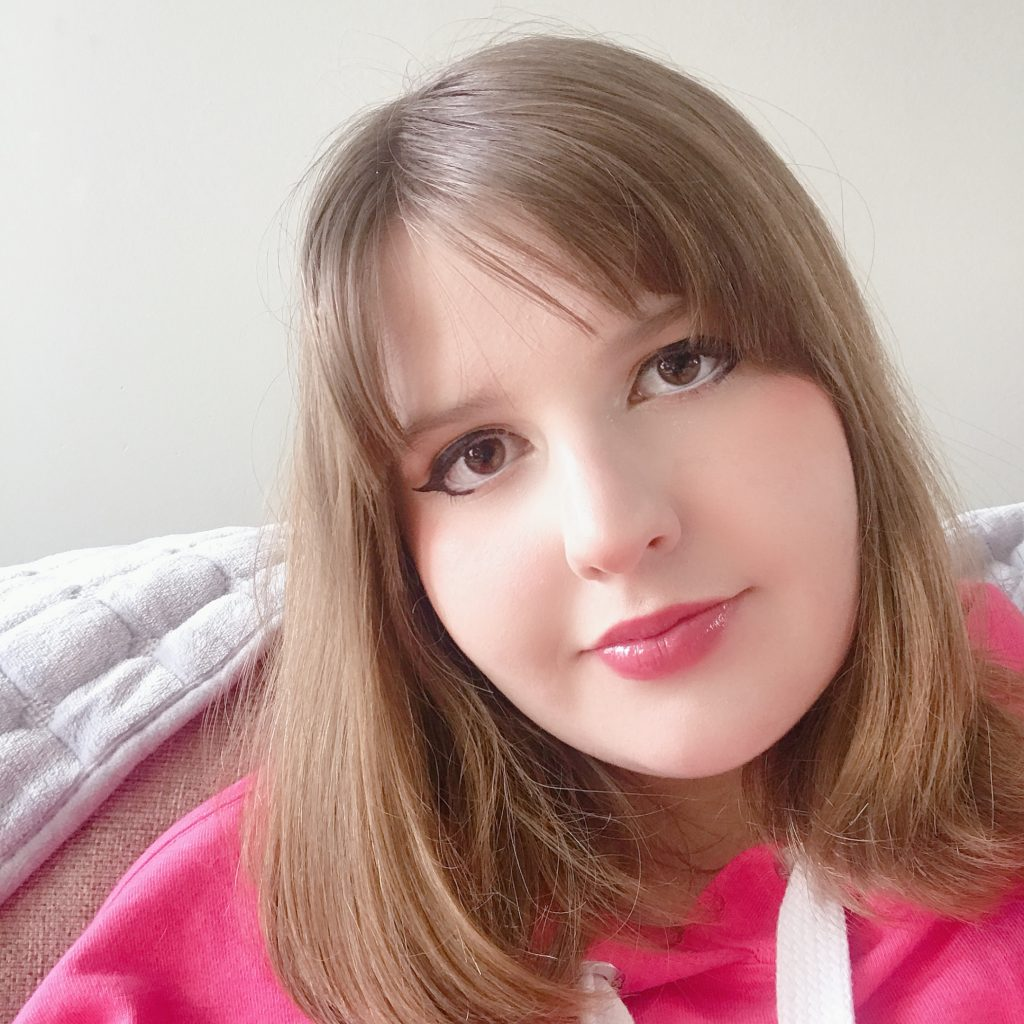 Selfie of Maddie in a pink hoodie.