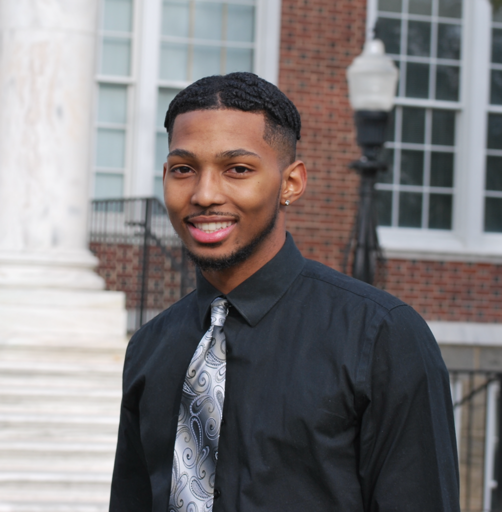 Chase Campbell smiles for his portrait in front of Bunce Hall.