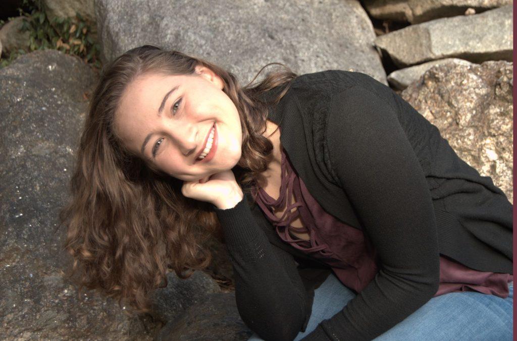 Photo of Kayla near some rocks.